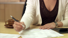 The hands of a woman paying bills, Sweden. Stock Footage