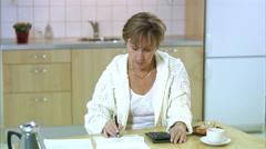 A Scandinavian woman paying her bills, Stockholm, Sweden. Stock Footage