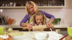 Mother and daughter baking together, Stockholm, Sweden. - stock footage