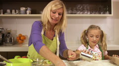 Mother and daughter baking together, Stockholm, Sweden. Stock Footage