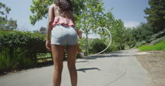 Young girlfriends jumping rope at the park Stock Footage