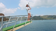 Girl in white on the yacht deck - stock footage