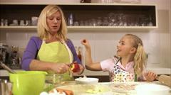 Mother and daughter baking together, Stockholm, Sweden. - stock footage