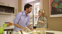 Father and son baking in the kitchen, Stockholm, Sweden. Stock Footage
