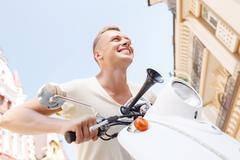 Low angle of man on scooter Stock Photos