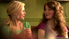 Two teenage girls talking, Stockholm, Sweden. - stock footage