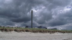 Dark sky above the nuclear reactor and power generating station EPZ Borssele - stock footage