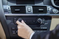 Hand adjusting the car button Stock Photos