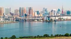Time-lapse of Tokyo Bay with a view of the Rainbow Bridge and the Tokyo skyline Stock Footage
