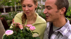 A Scandinavian couple looking at a flower, Stockholm, Sweden. Stock Footage