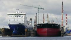 Two ships during renovation in docks at Gdansk shipyard Stock Footage