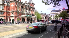 Traffic cars in front of National Ballet and Opera house,Amsterdam Stock Footage