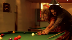 Man helping a woman playing billiards, Stockholm, Sweden. Stock Footage