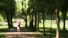 Woman running in a park, Sweden. Stock Footage