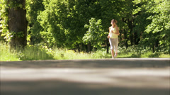 Scandinavian woman jogging, Sweden. Stock Footage