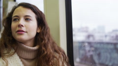 4k Attractive female looking thoughtful sitting on a moving train - stock footage