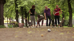 People playing boules in a park, Stockholm, Sweden. Stock Footage