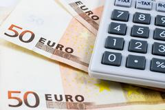 fifty euro bills and a calculator - stock photo