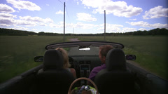 A couple in a cabriolet, Vallentuna, Sweden. Stock Footage