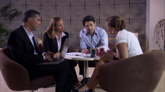 Four persons having a meeting in an office, Sweden. - stock footage