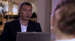 A man and a woman sitting in an office, Sweden. - stock footage