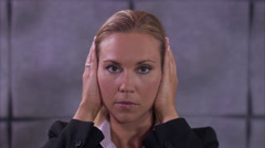 A business woman holding her hands over her ears and opening her mouth, Sweden. Stock Footage