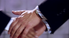 The hands of two business people shaking hands, Sweden. Stock Footage