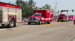 Firetrucks and EMT vechicles in the 4th of July Parade - stock footage