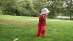 A little girl toddling around, Stockholm, Sweden. Stock Footage