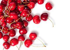 Pours pile of juicy sweet cherries Stock Photos