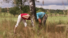 Two people looking for a golf ball, Sweden. Stock Footage