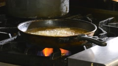 Deep frying onion rings Stock Footage
