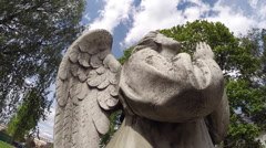 Figure of an angel on the tombstone (monument) in the cemetery Stock Footage