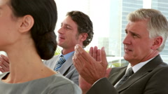 Business people applauding during meeting Stock Footage