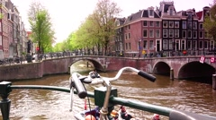 ULTRA HD 4k, Real time; Boats sail in Amsterdam canal Stock Footage