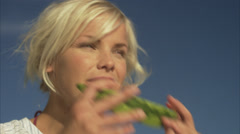 A young woman eating a watermelon, Blido, Stockholm archipelago, Sweden. Stock Footage