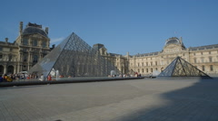 Louvre Museum Pyramids in Paris France with Tourists Stock Footage