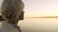 A young woman watching the ocean, Blido, Stockholm archipelago, Sweden. Arkistovideo