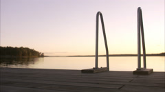 A ladder leading  into the ocean, Stockholm archipelago, Sweden. Stock Footage