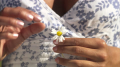 A woman with an oxeye daisy, Sweden. Stock Footage