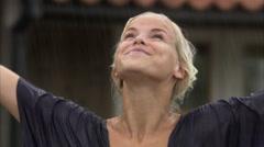 A woman enjoying the rain, Sweden. Stock Footage