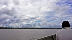 Man on Boat in the Amazon Stock Footage