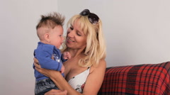 Happy Woman Taking Care Of Small Baby Boy Stock Footage