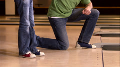 Father teaching daughter how to bowl, Sweden. - stock footage