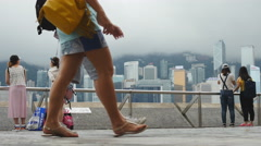 Two sets of friends admire view of Hong Kong 4K - stock footage
