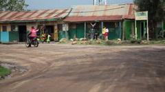 Motorbike and family, Maralal street, Samburu, Kenya, Africa Stock Footage