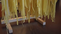 Hanging fresh fettuccine pasta on drying rack. 4K UHD. Stock Footage