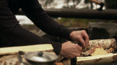 A man making a camp fire, Sweden. Stock Footage