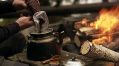 Making coffee over a campfire, Sweden. Stock Footage