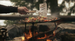 Cooking over a camp fire, Sweden. Stock Footage